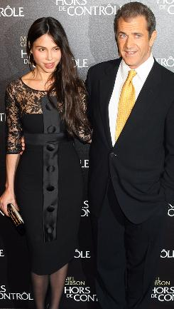 Mel Gibson and Oksana Grigorieva arrive at the Edge Of Darkness  premiere in Paris on Feb. 24.