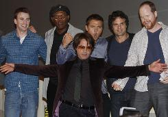 Robert Downey Jr. poses in the center of cast members of The Avengers.