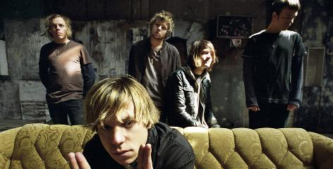 They have long memories, too: Jared Champion, Matt Shultz (on couch), Lincoln Parish, Daniel Tichenor and Brad Shultz have come a long way since getting their first drum kit courtesy of a trash bin.