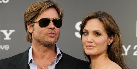 """Mr. Mom"": That's what Andrew Morton calls Brad Pitt in the book. He also says Pitt's relationship with Angelina Jolie is a ""constant vying for supremacy."""