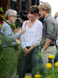 Woody Allen,  Carla Bruni-Sarkozy and Owen Wilson in a scene from Allen's upcoming film,  Midnight in Paris .