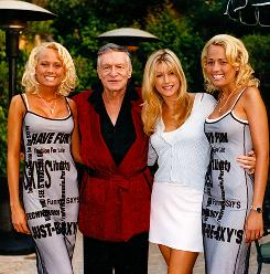 He's still got it: Hugh Hefner in 1998 with his girlfriends at the time, twins Sandy, left, and Mandy Bentley, and Brande Roderick, center.