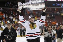 Chicago Blackhawks center Jonathan Toews hoists the Stanley Cup on June 9 after his team beat the Philadelphia Flyers 4-3 in overtime to win Game 6 of the NHL Stanley Cup hockey finals on the road in Philly.
