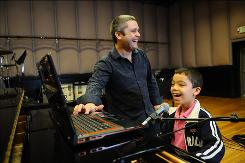 Ethan Bortnick, 9, with his father, Gene, rehearses for two concerts featured in the PBS special Ethan Bortnick and His Musical Time Machine. Ethan started playing as a tot on a Sesame Street Elmo keyboard.