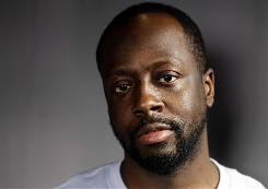 Musician Wyclef Jean, seen here in May in Los Angeles, has resigned from the charity he founded to run for president of Haiti.
