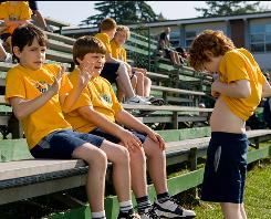 Greg (Zachary Gordon, left) and Rowley (Robert Capron) are horrified by Fregley's (Grayson Russell) navel peculiarity in Diary of a Wimpy Kid.