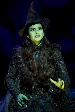 Raking in the green: Mandy Gonzalez as Elphaba in the hit musical Wicked.