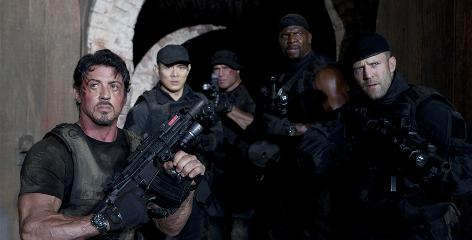 Rambo reborn: Tough guys Sylvester Stallone, left, Jet Li, Randy Couture, Terry Crews and Jason Statham are a particularly violent corps of mercenaries.