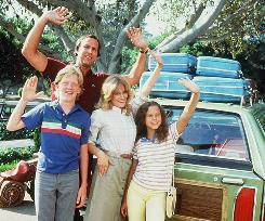 Holiday Road: Chevy Chase, left, Anthony Michael Hall, Beverly D'Angelo and Dana Barron embark on the first Griswold family Vacation.