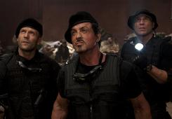 The Expendables, with Jason Statham, left, Sylvester Stallone and Randy Couture, was No. 1 at the box office this weekend.