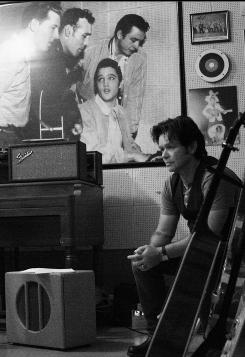 In Memphis: John Mellencamp recorded at Sun Studio with (a portrait of) Jerry Lee Lewis, Carl Perkins, Elvis Presley and Johnny Cash looking on.