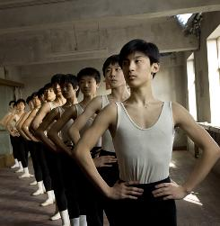 Raising the bar: Ballet students go through their lessons in Mao's Last Dancer, in theaters Friday. It's based on the true story of Li Cunxin, a dancer who defected to the USA from China in 1981.