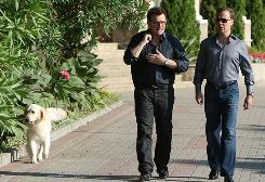  Bono and Russian president Dmitry Medvedev take a walk at the Bocharov Ruchei residence, near the Black Sea resort town of Sochi, which will host the 2014 Winter Olympics.