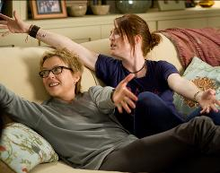 Annette Bening, left, and Julianne Moore are a couple with kids in The Kids Are All Right, now playing in theaters.