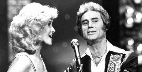Tammy Wynette sings with the most famous of her five husbands, George Jones.