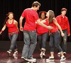 Glee: Cory Monteith and Lea Michele take the lead on Don't Stop Believin' with backup from Jenna Ushkowitz, left, Amber Riley and Chris Colfer on the new Fox musical comedy, which is up for 19 Emmys, making it the most-nominated series.