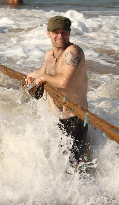 Beyond Survival With Les Stroud: The show's star wades into the surf in Sri Lanka.