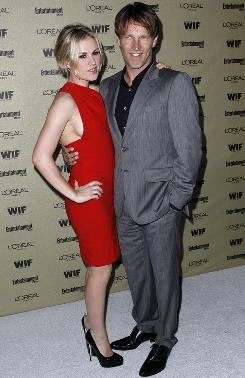 Newlyweds and True Blood co-stars Anna Paquin and Stephen Moyer didn't speak to press, but they obliged photographers with some post-nuptial smiles at the Entertainment Weekly and Women in Film pre-Emmy party in West Hollywood on Friday.