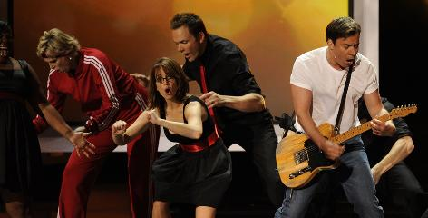 Host Jimmy Fallon, right, leads actors Jane Lynch, Tina Fey and Joel McHale during an opening number inspired by the show Glee.