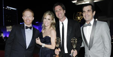 Modern Family creator Steven Levitan, second right, double-fists his Emmys while celebrating at the Governor's Ball with cast members Jesse Tyler Ferguson, left, Julie Bowen and Ty Burell. All three were nominated as supporting comedic players.