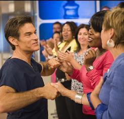 Amid handshakes and questions, Dr. Oz chats with fans at his show's New York studio.