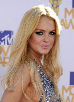 Back to work: Lindsay Lohan, who was just released from jail, also stars in Machete.