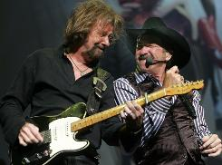 """This is not a funeral,"" Kix Brooks, right, told the audience as he and partner Ronnie Dunn began their farewell performance. ""We did show up to party."""