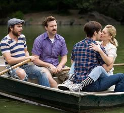In their own little world: Dan (Charlie Day, left) and Box (Jason Sudeikis) play third and fourth wheel during a romantic ride with Garrett (Justin Long) and Erin (Drew Barrymore).