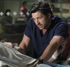 Aftermath of a tragedy: In the season premiere, Derek (Patrick Dempsey) is back at work treating a patient (Matthew Fahey) and feeling invincible on Grey's Anatomy.