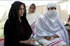 UNHCR goodwill ambassador Angelina Jolie visits people displaced by the floods in northwest Pakistan at the Kandaro II Camp in Nowshera, Khyber Pakhtunkhwa Province on Tuesday.