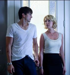 In Killers, Ashton Kutcher plays a hit man, but Katherine Heigl's character didn't know that when she married him.