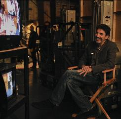 Executive producer Chuck Lorre watches a Mike & Molly taping. He also oversees Two and a Half Men and The Big Bang Theory.