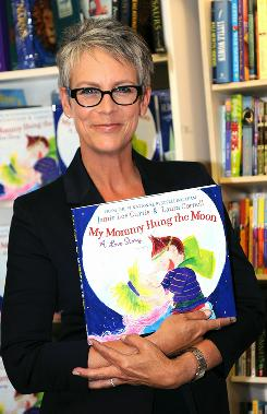 They make world go round: Jamie Lee Curtis promotes My Mommy Hung the Moon last week in Ridgewood, N.J.