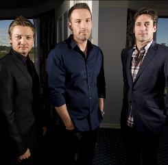 Jeremy Renner, left, Ben Affleck and Jon Hamm star in The Town, which Affleck directs. The crime drama is in theaters Friday.
