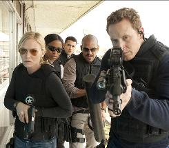 Marshals on a mission: Kelli Giddish, left, Rose Rollins, Jesse Metcalfe, Amaury Nolasco and Cole Hauser.