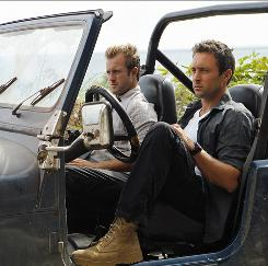 "They're on the lookout: Alex O'Loughlin, right, stars as Steve McGarrett, and Scott Caan is Danny ""Danno"" Williams in the remake, which features a beautiful setting and plenty of action."