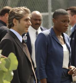 Michael Imperioli and Aisha Hinds work a crime scene in Detroit 1-8-7.