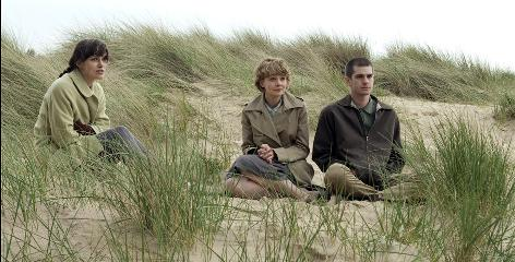 "Looking through a ""dark mirror"": Keira Knightley, left, Carey Mulligan and Andrew Garfield star in British film Never Let Me Go, which has a futuristic message but is actually set in the late 1990s."
