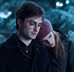 Harry Potter (Daniel Radcliffe) and Hermione Granger (Emma Watson) share a sobering moment when they visit the graves of Harry's parents in Harry Potter and the Deathly Hallows: Part 1, due Nov. 19.
