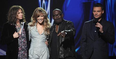 And then there were three (again): Steven Tyler, left, and Jennifer Lopez are officially joining Randy Jackson on American Idol's judging panel for Season 10.  Host Ryan Seacrest, right, returns.