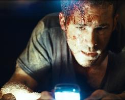 Ryan Reynolds is stuck in a coffin in Iraq with  a cellphone and a lighter, but he gets nothing when he calls for help.