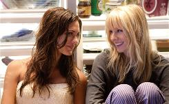 Joanna (Odette Yustman, left) was mean to Marni  (Kristen Bell) in high school. Now they're going to be sisters-in-law.