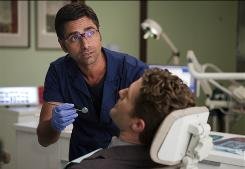 Dr. Howell (John Stamos) checks out Will's (Matthew Morrison) teeth in Tuesday's fantasy episode.
