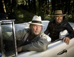In the driver's seat: Neil Young, left, and producer Daniel Lanois recently finished Young's new album, Le Noise.