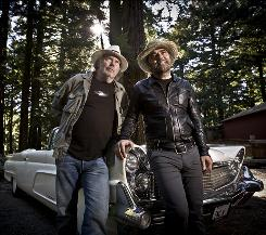 "Neil Young, left, is a mechanical wizard, proud of his ""green"" white '59 Lincoln. Daniel Lanois is the sonic wizard behind Young's Le Noise."