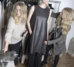 """""""We're in every meeting"""": Ashley, left, and Mary-Kate Olsen prepare for their big fashion show in Paris Sunday in The Row design studio in New York City."""