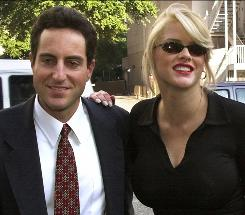 The prosecutor in the Anna Nicole Smith conspiracy case portrayed the late model as having pressured her inner circle, including her lawyer boyfriend, Howard K. Stern  to procure prescription drugs for her.