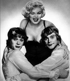 Curtis, left, shows off his drag queen chops in 1959's Some Like It Hot, in which he co-starred alongside Jack Lemmon and Marilyn Monroe.