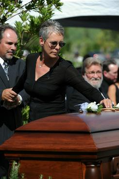 Actress Jamie Lee Curtis places a flower on the casket of her father Tony Curtis at the Palm Mortuary and Cemetery in Las Vegas Monday.