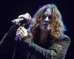 Add Ozzy Osbourne to the list of artists to cover a John Lennon song.